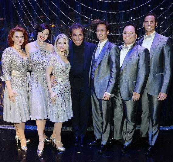Steve Wynn's ShowStoppers vocalists Kerry O'Malley, Lindsay Roginski, Nicole Kaplan, Steve Wynn, vocalists David Burnham, Randal Keith and Andrew Ragone pose for a photo during the press conference following the grand opening of Steve Wynn's ShowStoppers at Encore Theater at Wynn Las Vegas