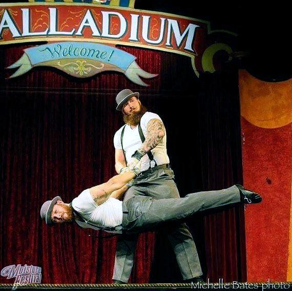Duo Ronin perform old time strongman style feats of strength and balance