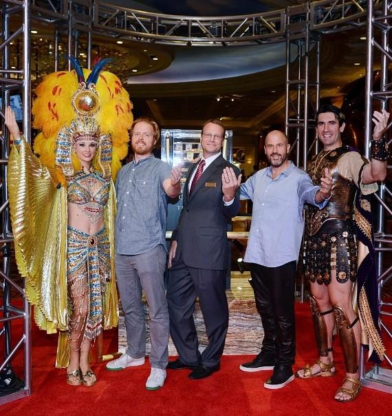 Co-author Nils Johnson-Shelton, Caesars Palace Vice President of Marketing Eric Proffitt and co-author James Frey pose with Caesar and Cleopatra in front of the gold display
