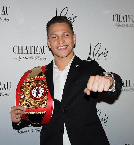 "Featherweight boxer Daniel ""Twitch"" Franco with his first title belt"