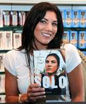 Hope Solo in front of Couture Pop wall in Sugar Factory