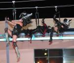 Aerialist perform mid air on Flightlinez zipline attraction at Fremont Street Experiece