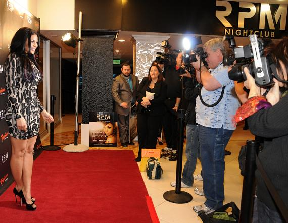 Jordin Sparks poses for photographers on red carpet at RPM Nightclub