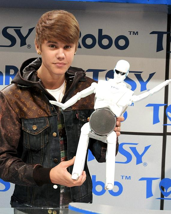 Justin Bieber unveils dancing robot at TOSY booth at CES in Las Vegas