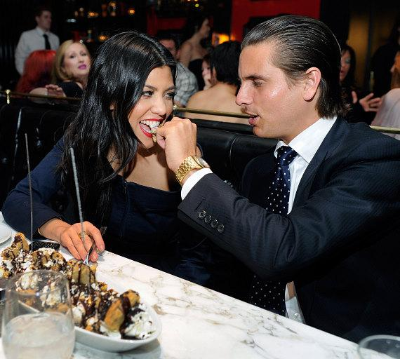 Kourtney Kardashian and Scott Disick eating an ice cream sundae at Sugar Factory American Brasserie