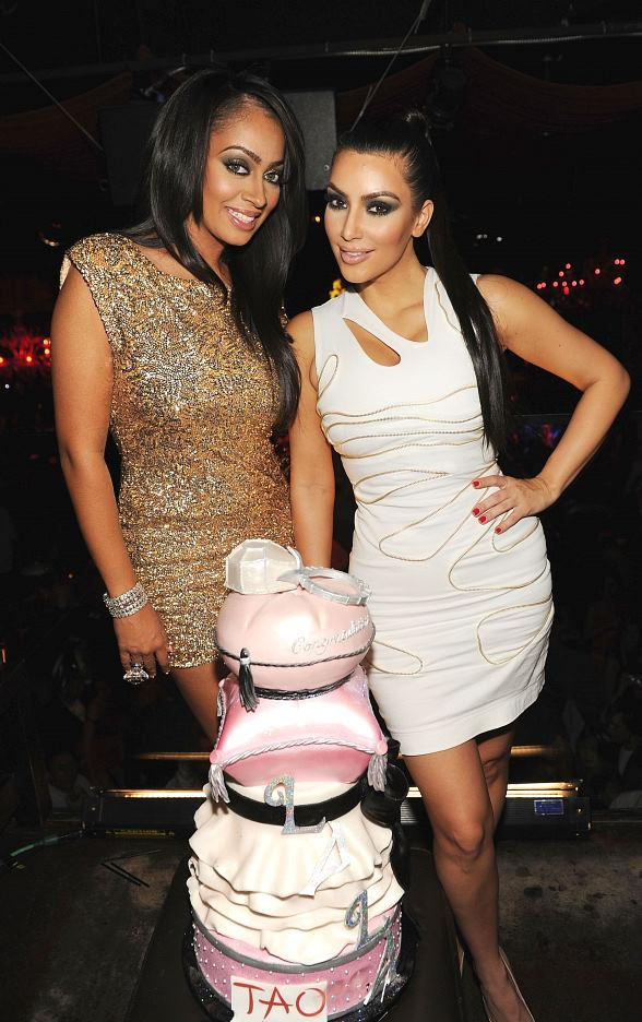 La La Vazquez and Kim Kardashian with cake at TAO