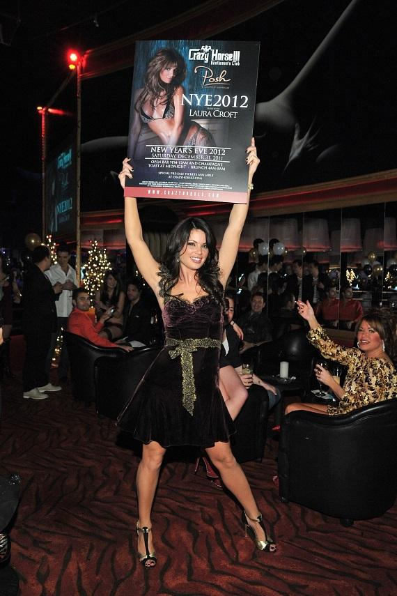 Laura Croft showing off her New Year's Eve poster at  Crazy Horse III