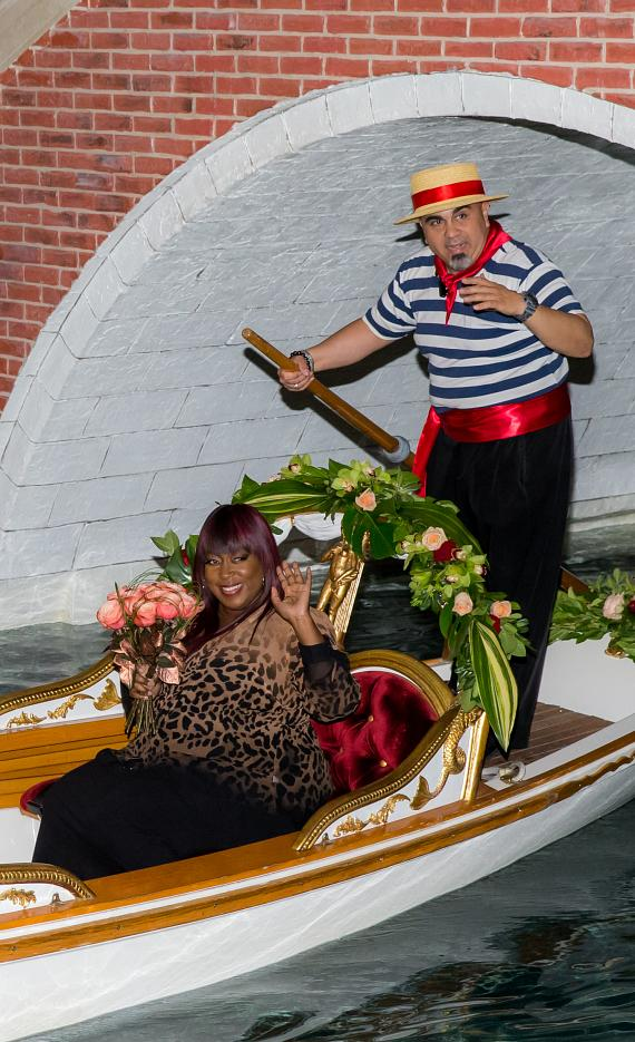 Loni Love arrives at the ceremony by gondola adorned with The Venetian Rose