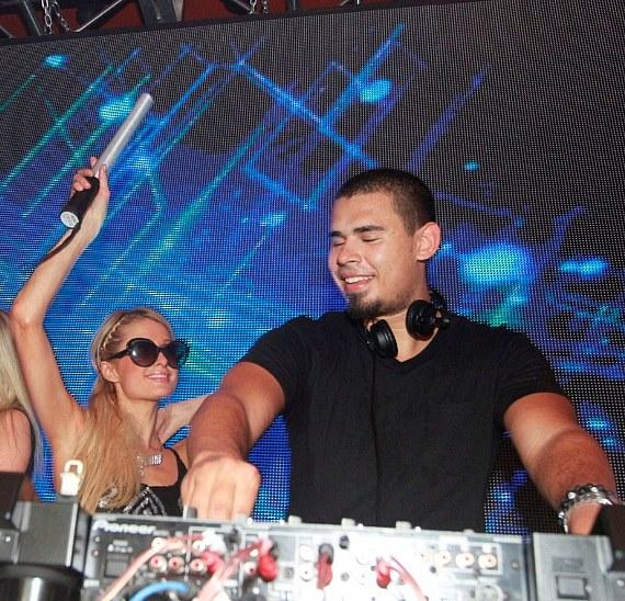 Paris Hilton in DJ booth with Afrojack at Surrender Nightclub