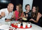 The McCord family eating fondue (From left: father David, AnnaLynne, sisters Angel and Rachel)
