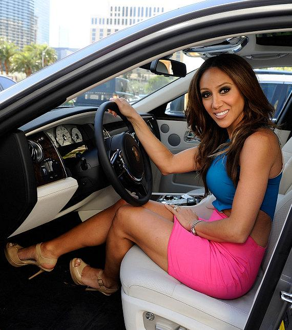 Melissa Gorga in driver's seat of Rolls-Royce Ghost from Towbin Motorcars