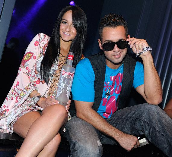 """Mike """"The Situation"""" Sorrentino and his sister, Melissa, pose with a bottle of his Devotion Vodka at Chateau Nightclub & Gardens"""