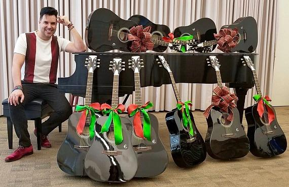 Frankie Moreno with 10 Gibson guitars he is donating to Nevada School of Arts