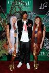Nick Cannon with the Butterfly girls on Chateau Gardens red carpet