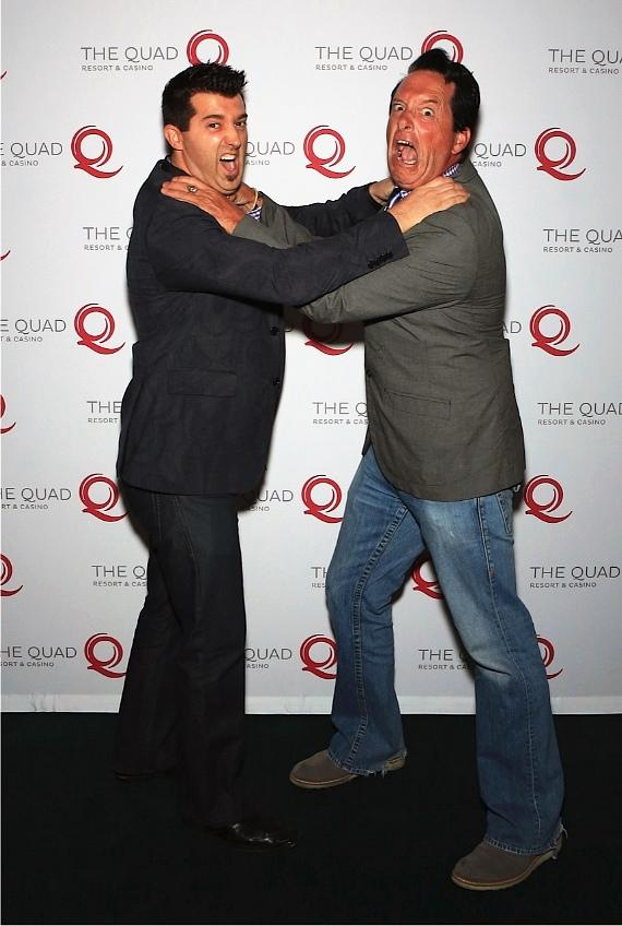 It's the battle of the comedian hypnotists, Paris headliner Anthony Cools and Marc Savard pose together for a funny photo op