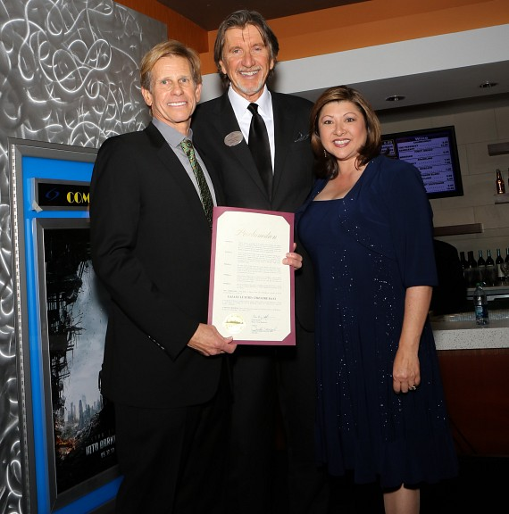 Councilwoman Gerri Schroder presents Galaxy Theatres executives with a proclamation from Mayor Andy A. Hafen proclaiming Mar. 7-10 Galaxy Luxury+ Days. Pictured left to right: Rafe Cohen President of Galaxy Theatres; Frank Rimkus, Chief Executive Officer of Galaxy Theatres; Gerri Schroder, Henderson Councilwoman.