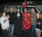 UFC visitors Dana White and their families pose with Fright Dome owner Jason Egan (priest) and his girlfriend Cheyenne Ruether (nun)
