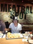 Ryan Cabrera enjoying a pepperoni and pineapple pizza at Meatball Spot