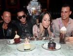 The Sorrentinos and Sussman watch as Melissa blows out her birthday candles of her decadent Sugar Factory desserts