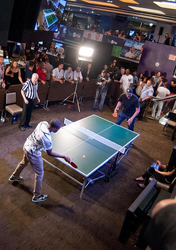 Spectators watch C.J Watson and John Wallace at the 2015 TopSpin Charity Ping Pong Tournament