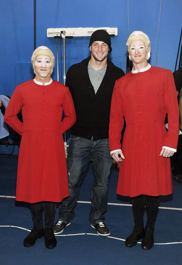 """Tim Tebow with Contortionists at """"O"""" by Cirque du Soleil"""