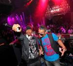 """Nick Cannon and Mike """"The Situation"""" Sorrentino in the DJ booth at Chateau Nightclub & Gardens"""