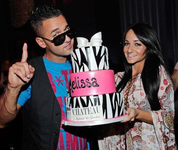 "Mike ""The Situation"" Sorrentino and his sister, Melissa, pose with a bottle of his Devotion Vodka at Chateau Nightclub & Gardens"
