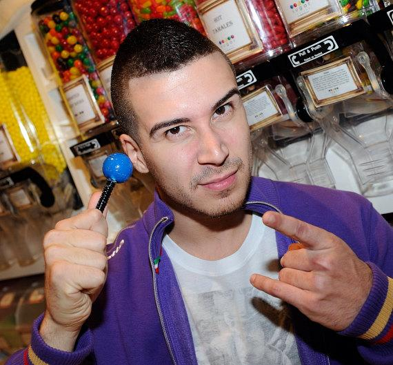 Vinny Guadagnino holding a blue Signature Sugar Factory Couture Pop at Sugar Factory