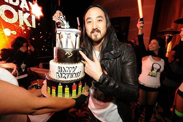 Steve Aoki with his birthday cake from Gimme Some Sugar