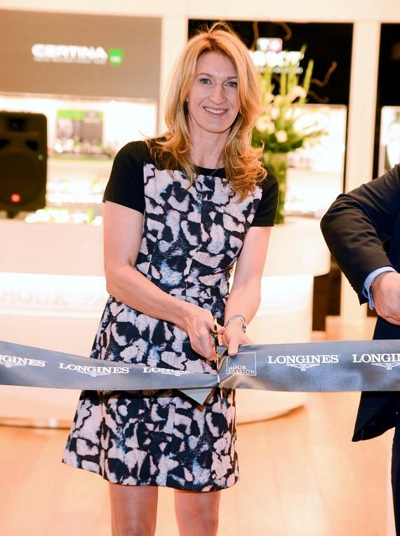 Stefanie Graf cuts the grand opening ribbon at Hour Passion at Aria Resort & Casino