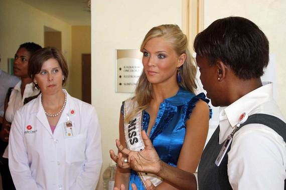 Dr. Karen Milligan, Miss USA, and Lori Goodwine (NVCI Chief Experience Officer) touring the facility.