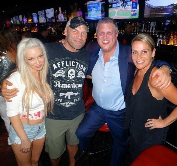 Mindy Robinson and Randy Couture with the D Owner Derek Stevens and wife Nicole Parthum at LONGBAR inside the D Casino Hotel
