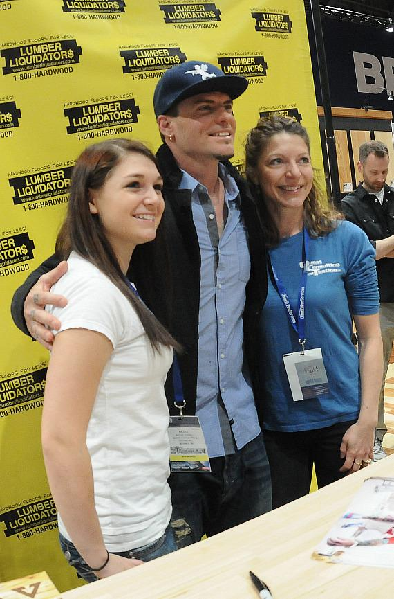 Vanilla Ice poses with fans in Lumber Liquidators Booth at 2013 Int'l Builders' Show
