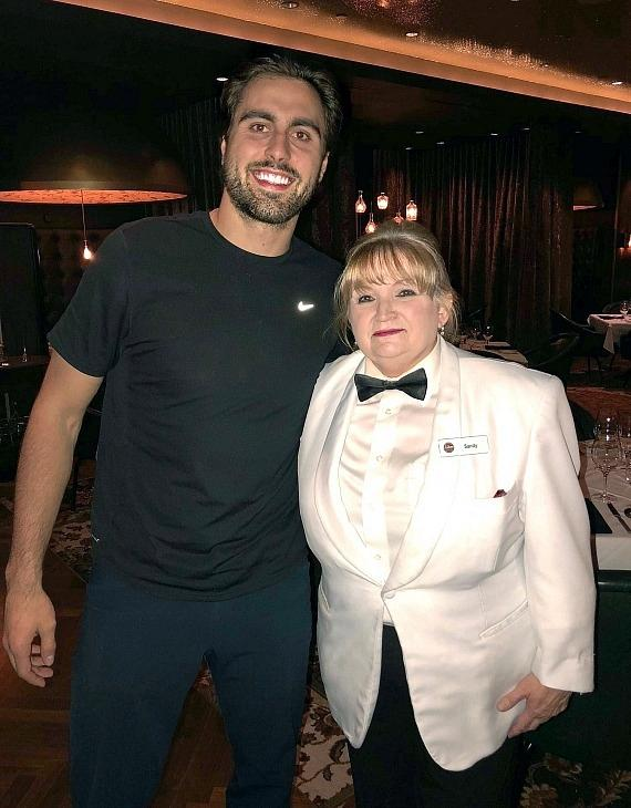 Vegas Golden Knights player Alex Tuch with Andiamo server Sandy in Las Vegas