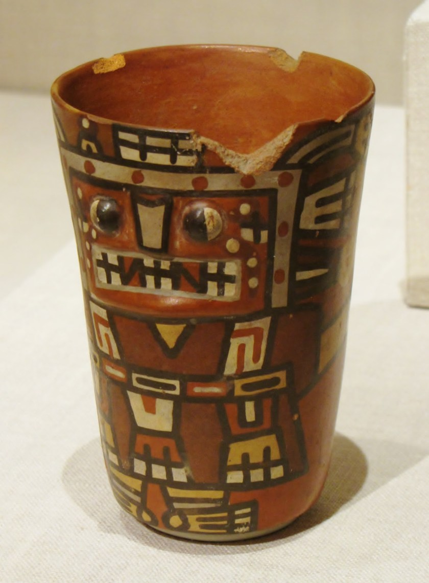 Drinking Cup (Kero) with an Abstracted Masked Figure, ceramic and pigment, 600/1000 CE, Tiwanaku-Wari, Bolivia or Peru