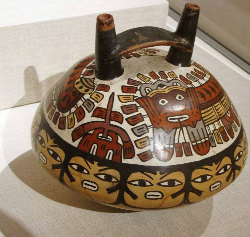 Double-Spouted Vessel Depicting Ritual Masks, ceramic and pigment, 180 BCE/500 CE, Nazca; South coast, Peru