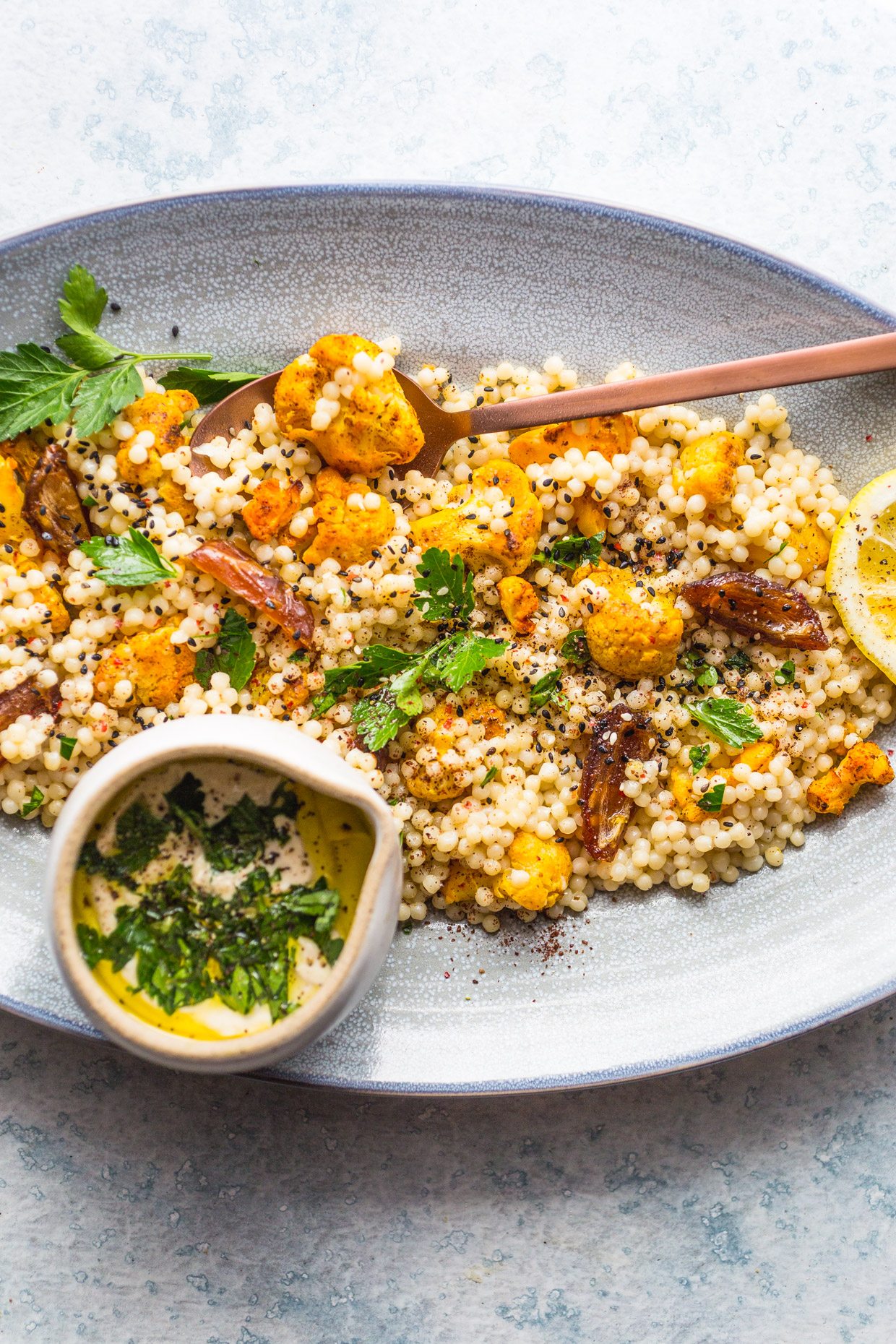 Roasted Cauliflower & Dates Couscous Salad with Creamy Tahini