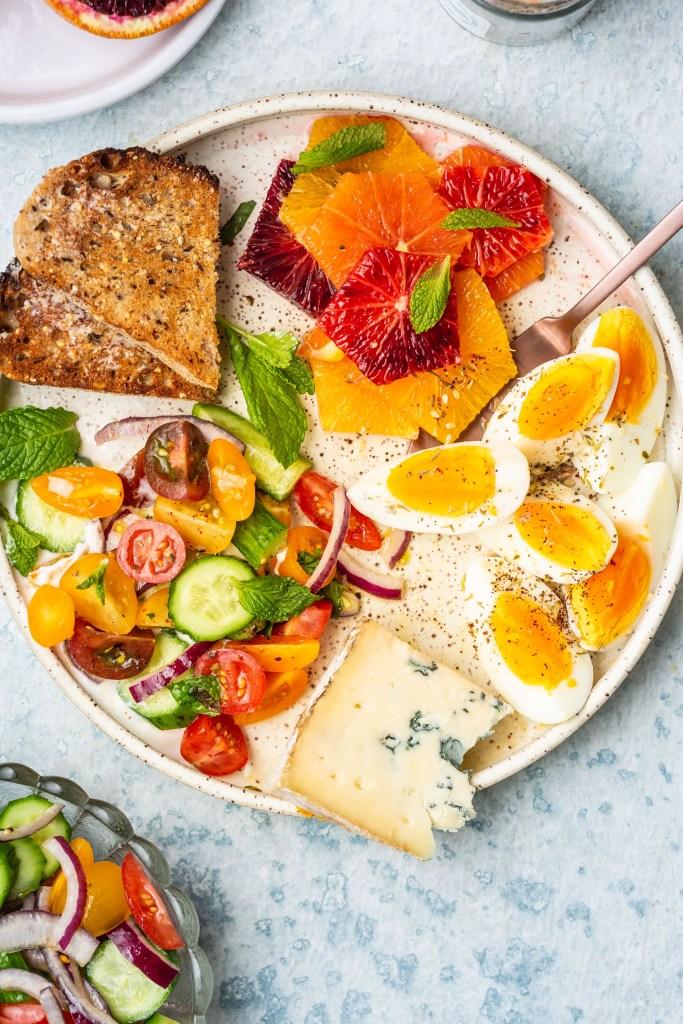 Vegetarian Breakfast Mezze Spread with Tomato Cucumber Salad & Za'atar Eggs