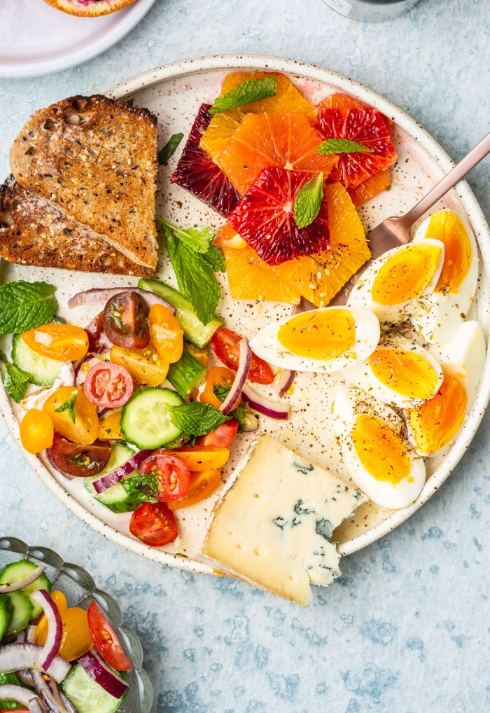Vegetarian Breakfast Mezze Spread with Tomato Cucumber Salad & Za'atar Eggs