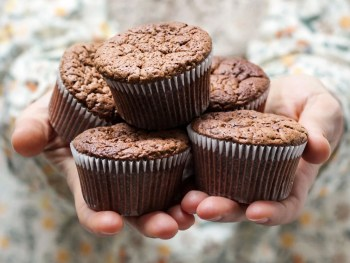 holding a stack of muffins