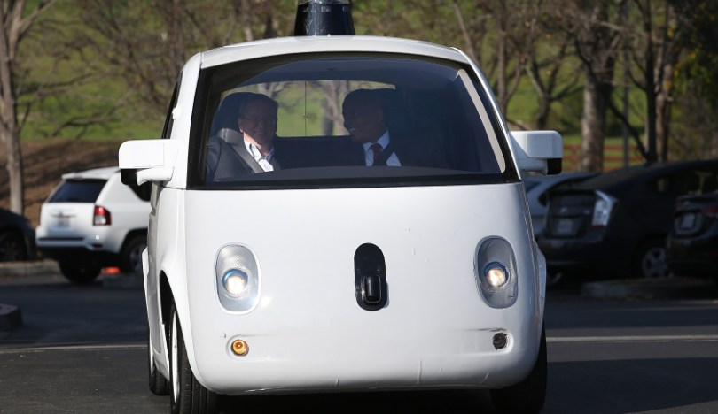 MOUNTAIN VIEW, CA - FEBRUARY 02:  U.S. Transportation Secretary Anthony Foxx (R) and Google Chairman Eric Schmidt (L) ride in a Google self-driving car at the Google headquarters on February 2, 2015 in Mountain View, California.  U.S. Transportation Secretary Anthony Foxx joined Google Chairman Eric Schmidt for a fireside chat where he unveiled Beyond Traffic, a new analysis from the U.S. Department of Transportation that anticipates the trends and choices facing our transportation system over the next three decades.  (Photo by Justin Sullivan/Getty Images)