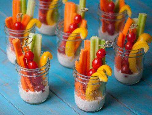 Vegetable sticks in glass mason jars
