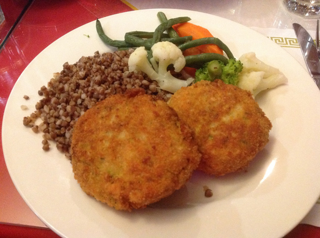 Potato Schnitzel served with assorted vegetables and a side of kasha. Hands down, our favorite dish.