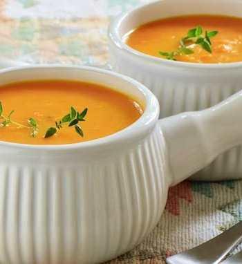 Orange Vegetable Soup carrot ginger in white bowl