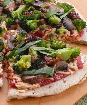 Vegan Broccoli, mushroom, and dried tomato pizza