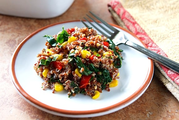 Red quinoa pilaf with kale and corn