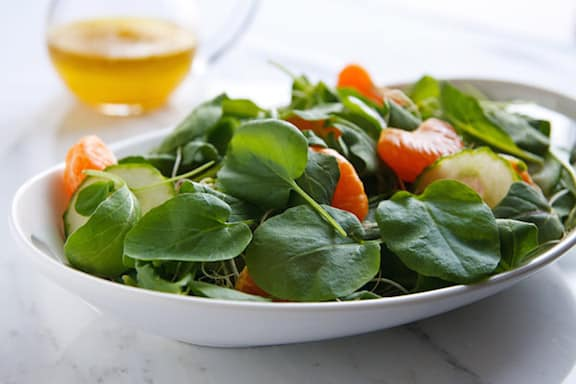 Spring greens salad with cucumbers and oranges