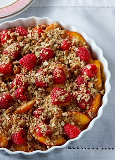 Unbaked vegan peach and raspberry crumble