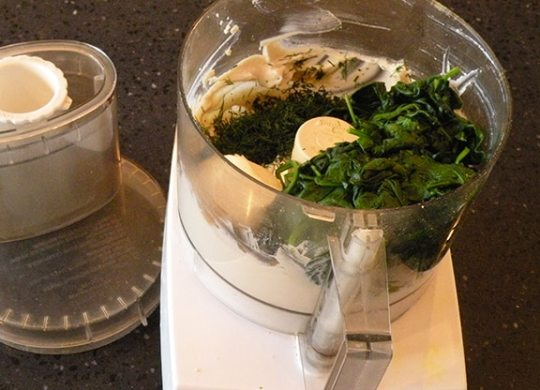 Ingredients for dairy-free creamed spinach in food processor