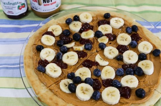 Breakfast peanut butter pizza with fruit and jam